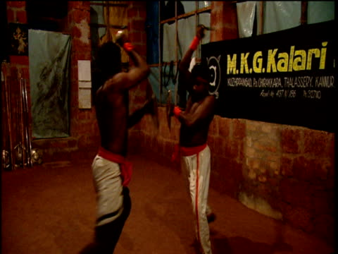 Men practice Kalarippayattu martial art Kerala India