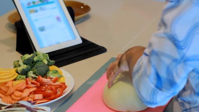 Men Preparing Meal and looking digitablet