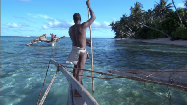 Men sail on outrigger canoes, Duff Islands, Solomon Islands