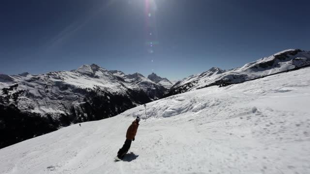 Men snowboarding and skiing  in ski resort