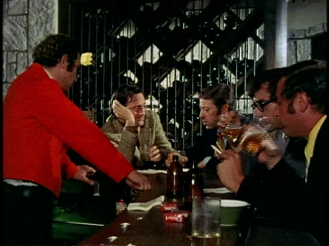1974 MONTAGE Men talking in bar, Los Angeles, California, USA