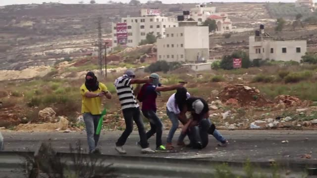 Men thought to be undercover Israeli policemen who had infiltrated a group of Palestinian stone throwers shot and wounded three of them one seriously...