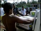 Men unload banana boxes from 4x4 in banana plantation Windward Island