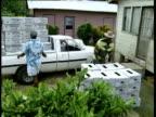 Men unload banana boxes from 4x4 Windward Islands