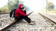 Men using Smart Phone near Railway Track