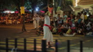 MS Men with whips parading in Buddhist Festival or Procession 'Esala Perahera' (Festival of Tooth) AUDIO / Kandy, Central Province, Sri Lanka
