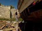 Men work on a replica of Noah's Ark.