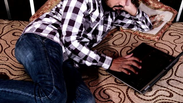 Men Working at Home using Laptop