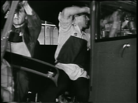 B/W 1932 3 men working inside car in Ford car factory / industrial