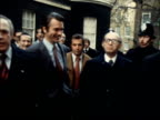 Menachem Begin visits London ENGLAND GV Begin leaves No 10 TRACK IN SOF 'Very well smiling faces' OFFICE BV Begin into Foreign Office MS Pan to Begin...