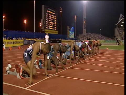 Men's 100m finalists prepare to start race 2003 International Athletics Grand Prix Crystal Palace London