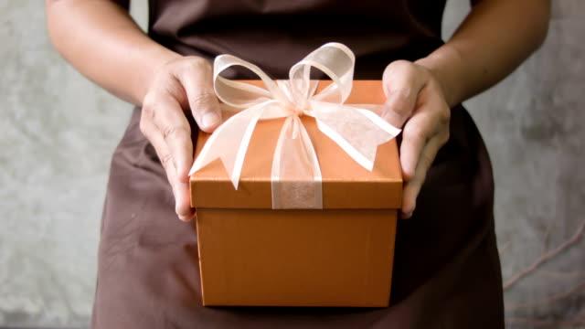 Men's hand holding gift box