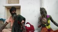 MS Men's playing damaru / Pushkar, Rajasthan, India