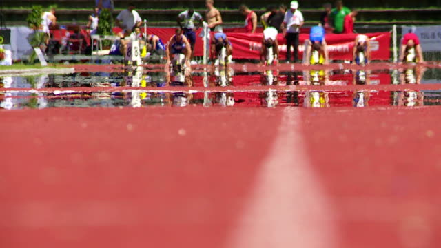 SLO MO Men's Running Track In The Summer Heat