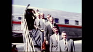 Mercury Program astronauts deplaning from American Airlines airplane wearing suits and posing for photographs on January 01 1961
