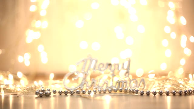 Merry Christmas text on the wooden background