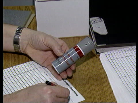 Merseyside MS Police in room as one towards to desk CMS CS gas cannister held in hand as registered on paper then handed over MS SIDE policeman...