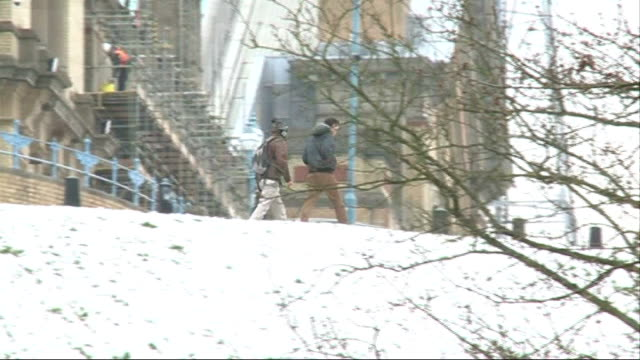 Met Office to hold meeting to discuss extreme weather trends T25031326 Alexandra Park People along through snow covered park as buildign work...