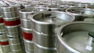 Metal beer kegs stored one beside the other