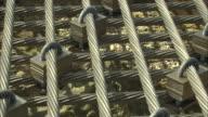 Metal cables and locks protect the original islets of Kita-Kojima in Okinotorishima Island, Japan.