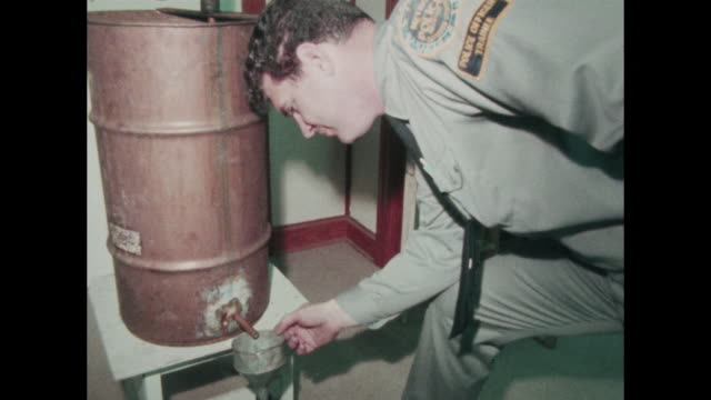 Metro Nashville police trainees cadets in uniform see a small whiskey still moonshine still some of the cadets are probably identifiable