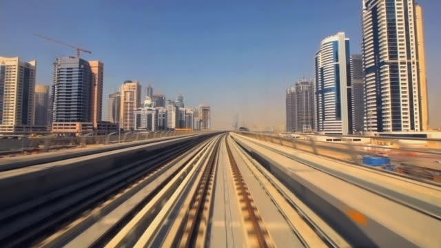 WS POV Metro rail riding through cityscape / Dubai, United Arab Emirates