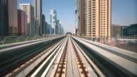 WS POV Metro rail riding through cityscape / Dubai, United Arab Emirates