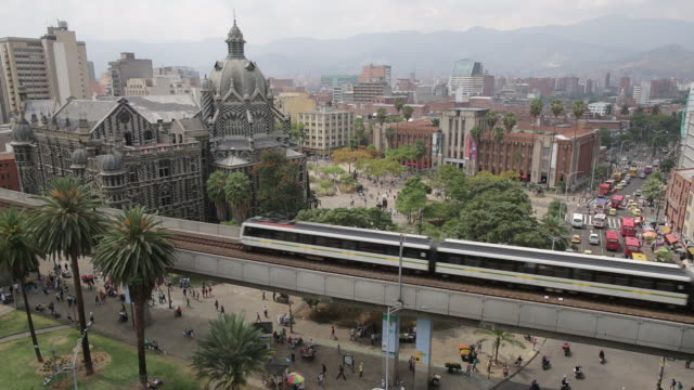MS Metro train on an elevated track above city traffic / Medellin, Colombia