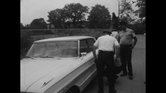 Metropolitan Police Mobile Crime Lab investigates car parked by Lockeland Elementary School on Woodland Street