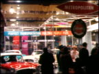Metropolitans on display at the 1959 Chicago Auto Show / MS literature booth pretty woman hands out literature to attendees / MS attendees file by a...