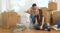 Mexican couple kissing after moving in
