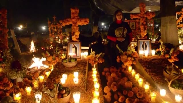 Mexicans honored their deceased loved ones all night long in cemeteries across the country for the Day of the Dead festivities