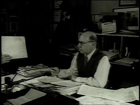 1962 MONTAGE Meyer Davis working at his desk / United States