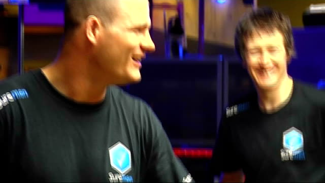 Michael Bisping interview Unidentified males training in UFC fighting in ring More of Bisping leading training in ring