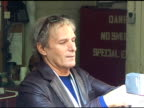 Michael Bolton signs autographs for fans as he departs 'Live with Regis Kelly' in New York 06/16/11
