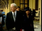 London Buckingham Palace EXT Sir Michael Caine along after investiture PULL CMS Insignia held
