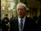London Buckingham Palace EXT Sir Michael Caine along after investiture Insignia held Sir Michael Caine interview SOT Talks of his conversation with...