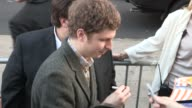 Michael Cera greets fans while arriving at the Arrested Development Season 4 Premiere in Hollywood 04/29/13