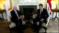 Michael D Higgins meets David Cameron at Downing Street Higgins and Cameron arriving in room shaking hands and taking seats / Cameron speaking SOT /...