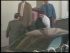 Michael Jackson freed on bail POOL via AGENCY Santa Barbara Jackson along from car with handcuffs on his wrists PAN