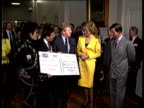 Michael Jackson presents Prince Charles and Princess Diana with a charity cheque and jackets for the young princes