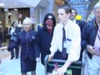Michael Jackson rushes through Heathrow to catch a flight to the USA Aided by airport staff he almost runs through terminal as aide carries a box of...