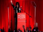 Michael Jackson signals to fans during 'This Is It' tour press conference London 5 March 2009