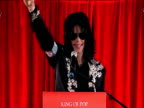 Michael Jackson signals to fans on stage during 'This Is It' tour press conference London 05 March 2009