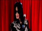 Michael Jackson waves goodbye to fans before leaving stage during 'This Is It' tour press conference 05 March 2009