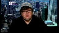 Michael Moore interview on global protests against cuts and corporate greed ENGLAND London GIR INT Michael Moore LIVE 2WAY interview from New York...