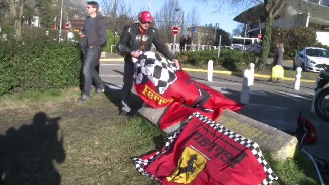 Michael Schumacher fans gather outside of hospital where retired seven time Formula One champion fights for his life after suffering severe brain...