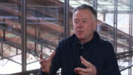 INTERVIEW Michael Winterbottom on documenting all aspects of touring using fictional characters to bring the real feeling of touring to the film at...