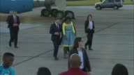 Michelle Obama arrives at Stansted Airport ENGLAND Essex Stansted Airport EXT Air Force One arrives taxiing on tarmac / Michelle Obama down steps of...