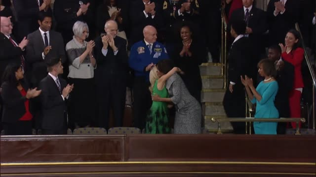 Michelle Obama takes her seat along with entourage to see President Barack Obama deliver the annual State of the Union